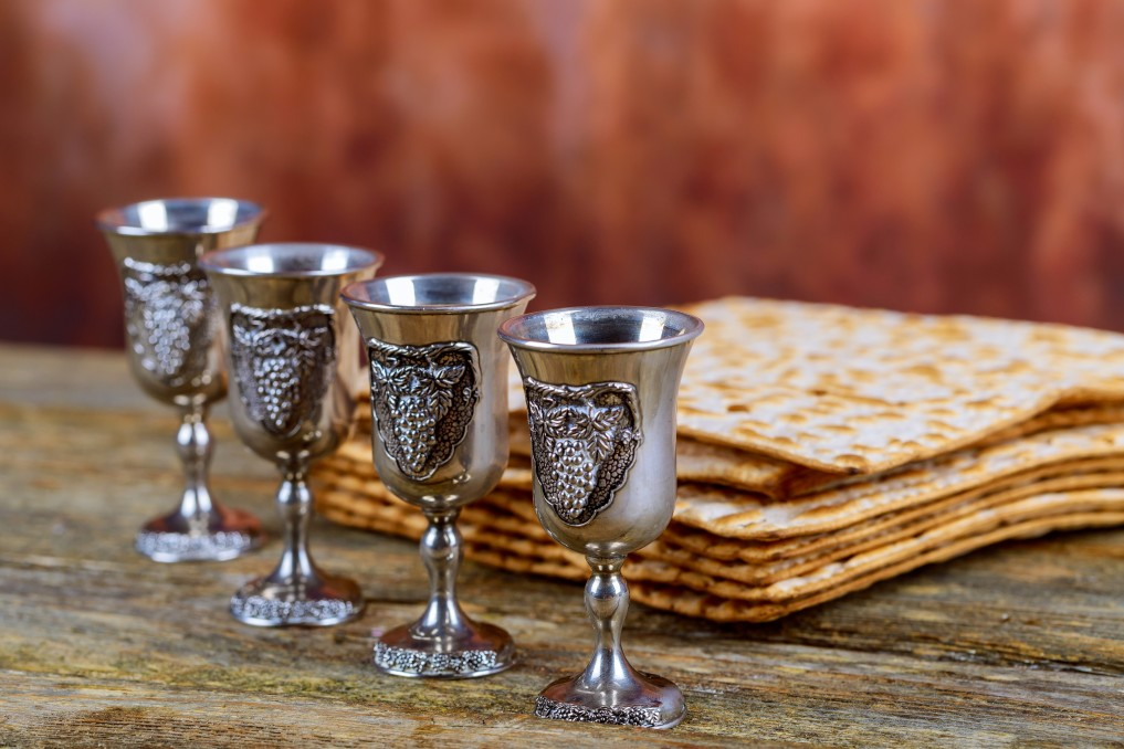 Four wine cups and a pile of matzo